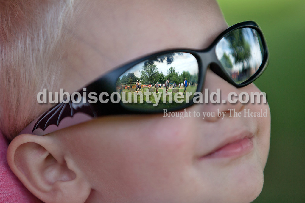 Brittney Lohmiller /The Herald <br /> Carter Schepers, 2, of Birdseye watched his father, Jon Schepers, play in the horseshoes tournament during Heimatfest at 18th Street Park Saturday afternoon.