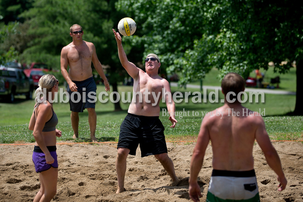 Brittney Lohmiller /The Herald <br /> Lee Volger of Dale of Dale hit the ball back while he competed in the co-ed volleyball tournament during Heimatfest at 18th Street Park Saturday afternoon.