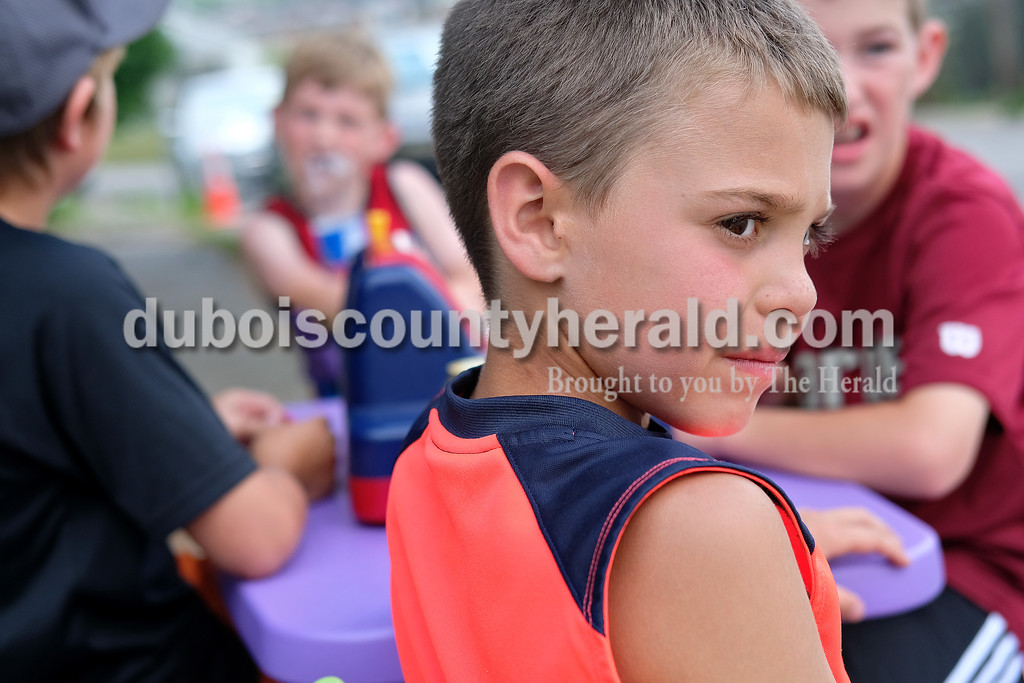 Kale Talbert of Jasper, 9, looked down the street as he heard a car approaching Monday afternoon.