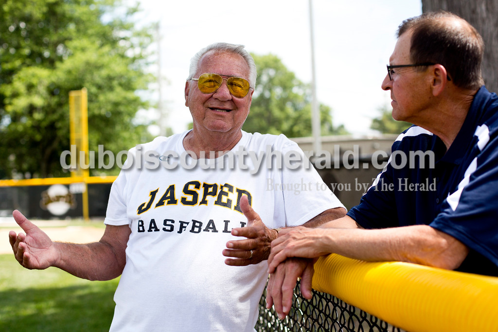 Tegan Johnston/The Herald<br /> Ray Howard of Jasper, former Jasper head coach, talked to Jim Gunselman of Jasper during Jasper baseball team's Wednesday afternoon practice at Ruxer Field in Jasper. The team will compete at the State championship this weekend in Indianapolis.