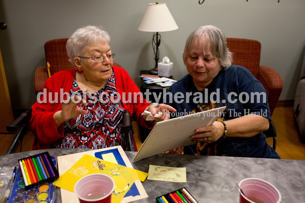 Tegan Johnston/The Herald<br /> Linda Foisy, left, admired the watercolor work her daughter, Paula, both of Ireland, had created while making bookmarks for new patient care packages during Tuesday's Creating Hope art class at Memorial Hospital in Jasper. Linda and Paula learned about the program while caring for Linda's husband, Tom, who passed away in 2015. The group meets every first and second Tuesday of the month to offer support to patients and caregivers while creating uplifting art.