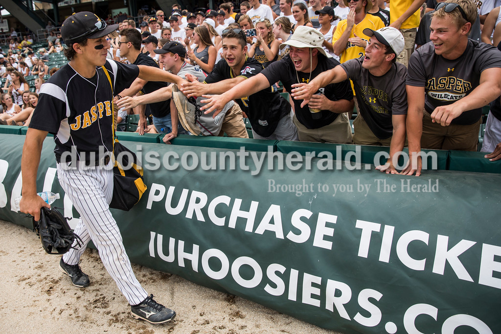 Jasper's Austin Simmers received high-fives from fans as he walked to the dugout before Saturday's Class 3A baseball state championship game at Victory Field in Indianapolis. South Bend St. Joseph defeated Jasper 4-0. Sarah Ann Jump/The Herald