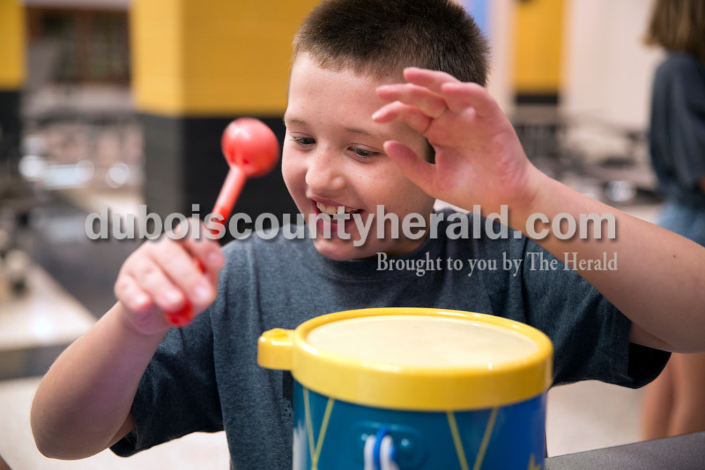 Sarah Ann Jump/The Herald<br /> Clayton Temple of Jasper, 9, played a drum during a session led by Pastor Paula Eyman of Calvary Door of Hope Church during Community CHEW at Jasper Middle School on Thursday afternoon.