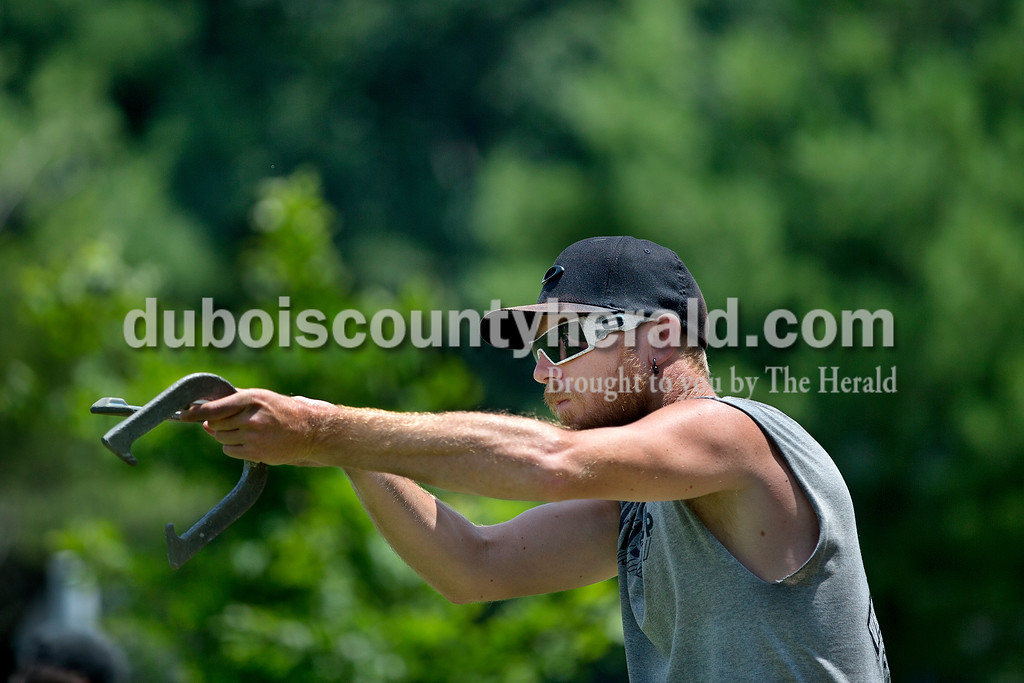 Brittney Lohmiller /The Herald <br /> Brad Cooper of Ferdinand lined-up his throw while competing in the horseshoes tournament during Heimatfest at 18th Street Park Saturday afternoon.