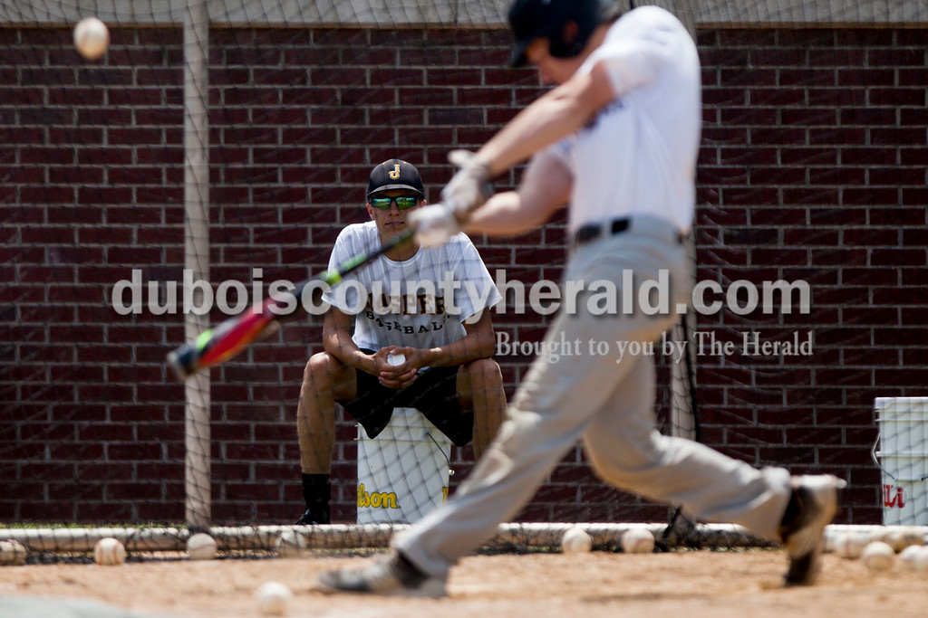 Tegan Johnston/The Herald<br /> Jasper's Johnny Verkamp watched his teammate Cameron Heeke bat during Wednesday afternoon's practice at Ruxer Field in Jasper. The team will compete at the State championship this weekend in Indianapolis.