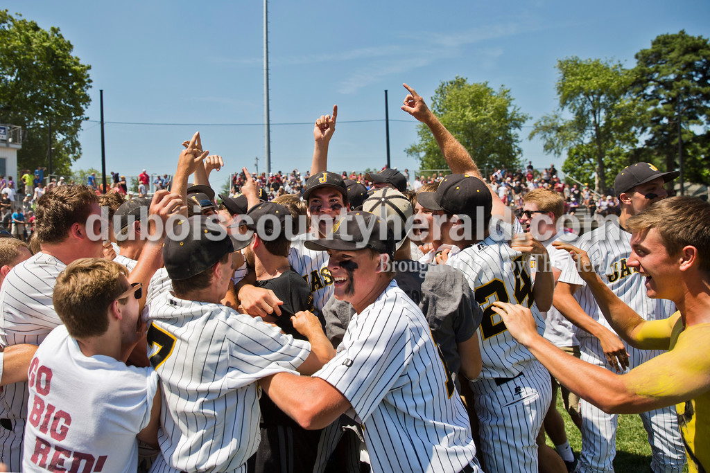 Jasper fans rushed the field to celebrate with players during Saturday's Class 3A baseball semistate game at Ruxer Field in Jasper. Jasper defeated Northview 3-2 in 10 innings. Sarah Ann Jump/The Herald