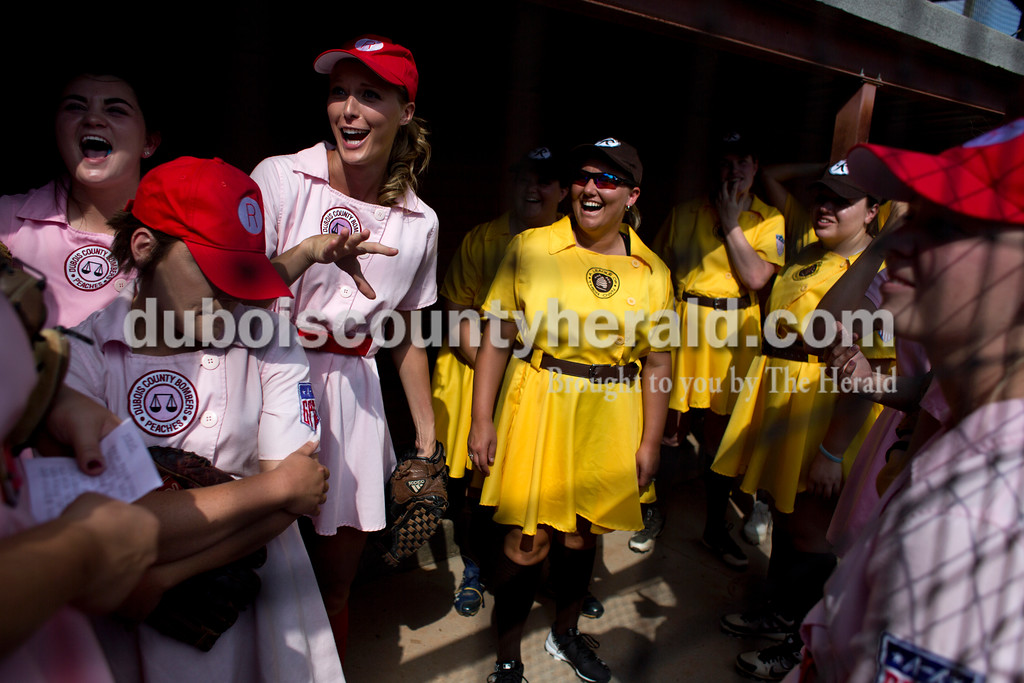 "Tegan Johnston/The Herald<br /> The Rockford Peaches and the Racine Belles chatted in the dugout together before playing at League Stadium on Saturday in Huntingburg during the 25th anniversary celebration of ""A League of Their Own."" The Peaches and Belles tied 8-8 during the 1940s-themed rematch."