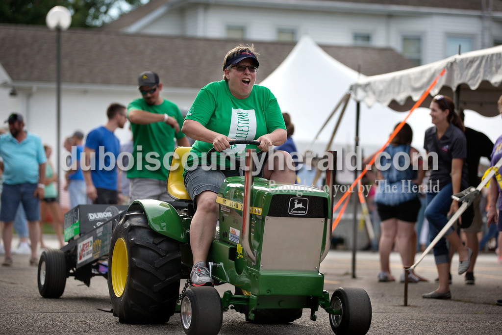 Brittney Lohmiller/The Herald <br /> Kathy Messmer of Celestine pedaled her tractor to the as far as she could Saturday afternoon during the 7th annual Celestine Streetfest. Messmer pulled her tractor 81 feet 9 inches.