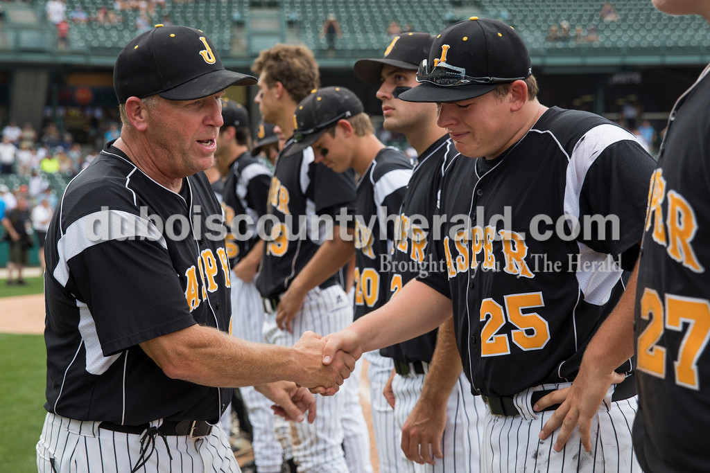 Jasper head coach Terry Gobert shook Mason Thewes' hand after Saturday's Class 3A baseball state championship game at Victory Field in Indianapolis. South Bend St. Joseph defeated Jasper 4-0. Sarah Ann Jump/The Herald