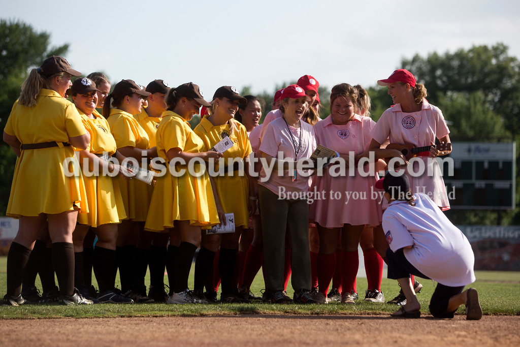 "Tegan Johnston/The Herald<br /> The Rockford Peaches and the Racine Belles sang the official All-American Girls Professional Baseball League victory song with Actress Bitty Schram, who played Evelyn Gardner in ""A League of Their Own,"" during the film's 25th anniversary celebration at League Stadium in Huntingburg on Saturday. The Peaches and Belles tied 8-8 during the 1940s-themed rematch."