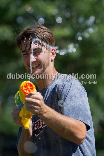 Sarah Ann Jump/The Herald<br /> Dubois County Bombers player Joey Antonopoulos of Plainfield, Ill. fired a squirt gun during Water Wars with the Dubois County Bombers at the Ferdinand Public Library on Tuesday.