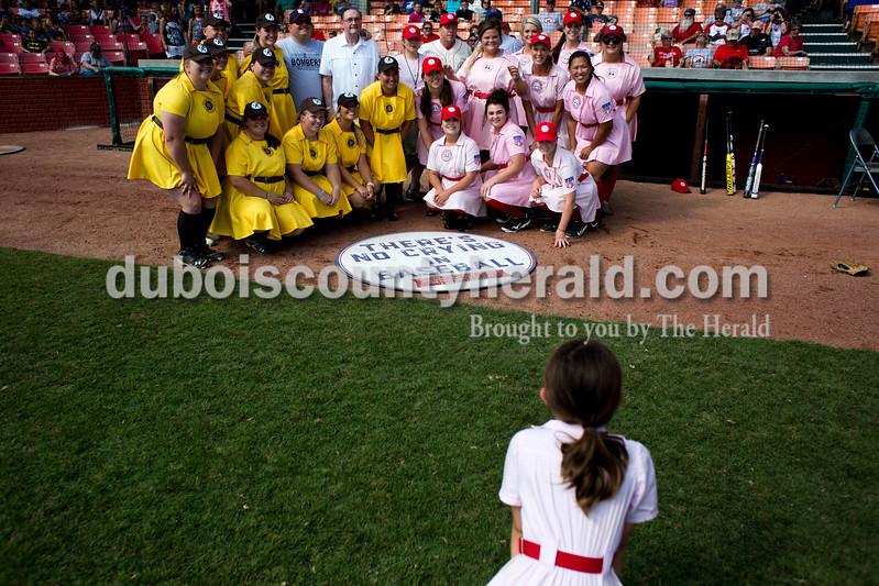 "Tegan Johnston/The Herald<br /> The Rockford Peaches and the Racine Belles gathered together for a picture with some of the original cast of ""A League of Their Own"" before Saturday's game at League Stadium in Huntingburg. During the 25th anniversary celebration, the Peaches and Belles tied 8-8 in the 1940s-themed rematch."