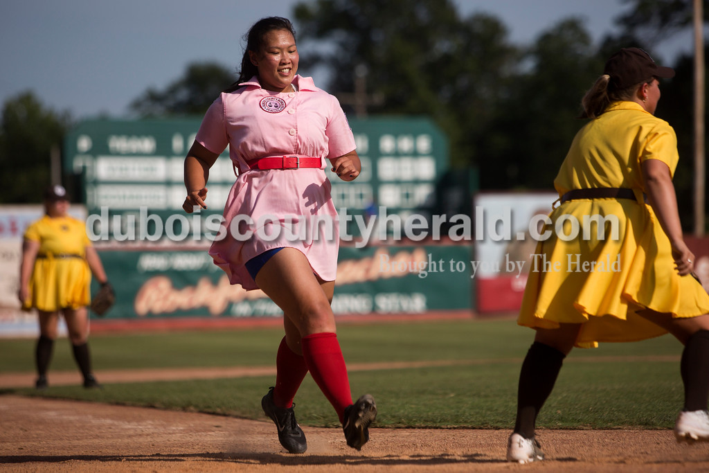 "Tegan Johnston/The Herald<br /> Rockford Peaches' Hayli Scott of Fulda ran to safely to home plate while playing at Saturday's game against the Belles at League Stadium in Huntingburg during the 25th anniversary celebration of ""A League of Their Own."" The Peaches and Belles tied 8-8 during the 1940s-themed rematch."