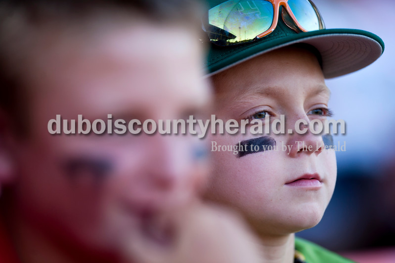 Tegan Johnston/The Herald<br /> Andrew Verkamp of Schnellville, 10, right, watched the game with his friend Evan Haas of Schnellville, 12, during Tuesday night's game at League Stadium in Huntingburg. The Bombers defeated Paducah 8-2.