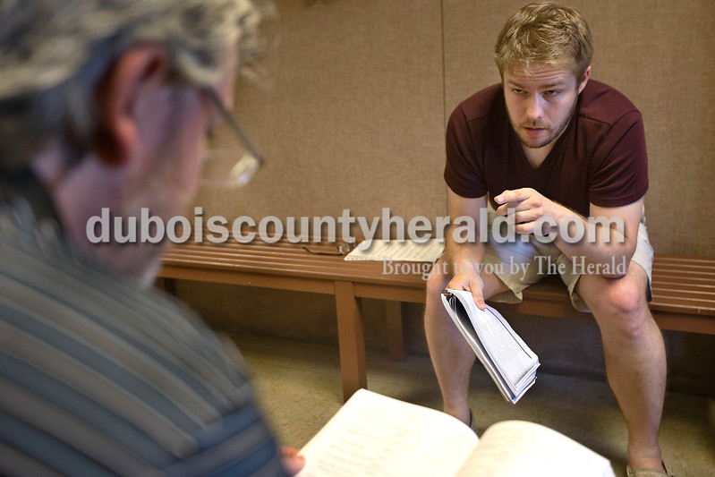 "Brittney Lohmiller /The Herald <br /> Director of the Jasper Community Arts Commission Kyle Rupert, left, practiced his cockney accent while reading through lines with Jadd Miller of Ferdinand at the Jasper Arts Center Tuesday evening. Rupert will be playing the part of Bill Sikes in the Actors Community Theater production of ""Oliver!"". ""I'm usually cast as the good guy so it will be fun to play Bill,"" Rupert said."