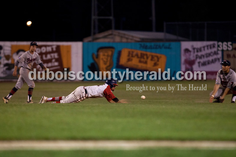 Tegan Johnston/The Herald<br /> Dubois County Bombers' Jake Slunder slid safely back to second base during Tuesday night's game at League Stadium in Huntingburg. The Bombers defeated Paducah 8-2.