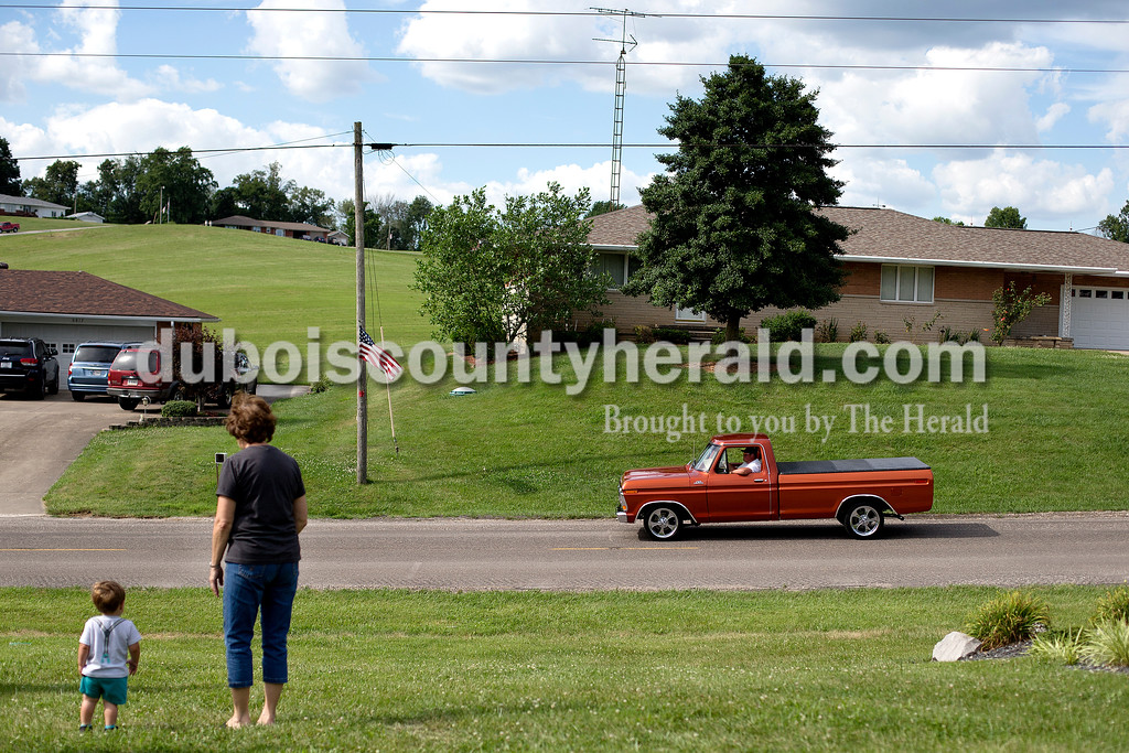 "Brittney Lohmiller/The Herald <br /> Sixteen-month-old Griffen Linne, left, and his grandmother Shirley Dillon, both of Dubois, watched an old truck cruise by Saturday afternoon during the 7th annual Celestine Streetfest. ""I have a 73' Corvette that we bring to shows like the one here, but I didn't bring it this time,"" Dillon said. This year's Streetfest started on Friday and ended Saturday with a car show, corn hole tournament, dunking booth, sheephead tournament and booths with games for attendees to play."