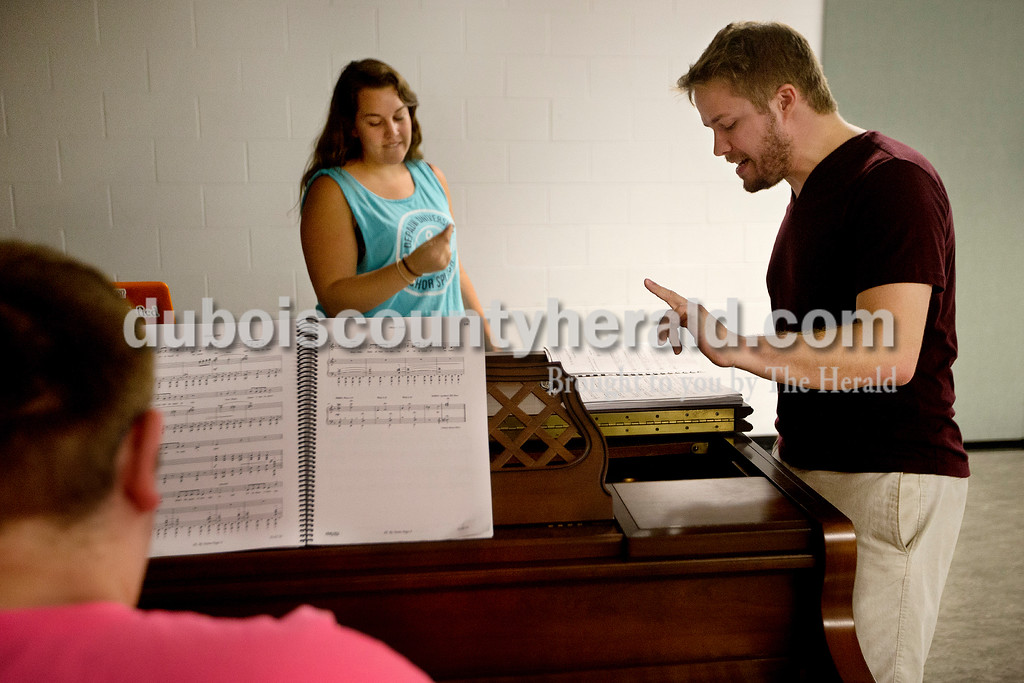 "Brittney Lohmiller /The Herald <br /> Actors Community Theater pianist Jonathan Kroger, left, Music Director Laura Witte and Director of the Jasper Community Arts Commission Kyle Rupert rehearsed a song from the upcoming performance of ""Oliver!"" at the Jasper Arts Center Tuesday evening."