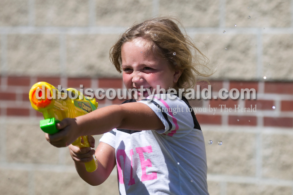 Sarah Ann Jump/The Herald<br /> Brooklyn Fleig of Ferdinand, 6, shot her squirt gun during Water Wars with the Dubois County Bombers at the Ferdinand Public Library on Tuesday.