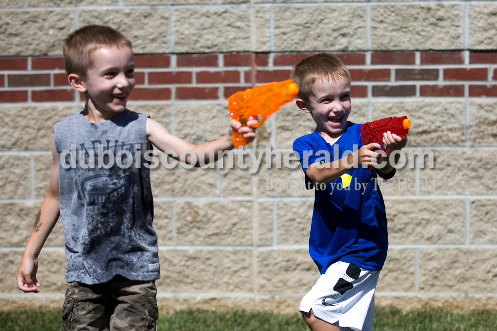 Sarah Ann Jump/The Herald<br /> Five-year-old triplets Max and Parker Werne participated in Water Wars with the Dubois County Bombers at the Ferdinand Public Library on Tuesday.