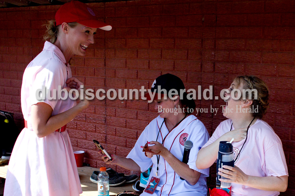 "Tegan Johnston/The Herald<br /> Rockford Peaches' Lauren Sergesketter of Holland talked with Actress Bitty Schram, who played Evelyn Gardner, during the 25th anniversary celebration of ""A League of Their Own"" at League Stadium in Huntingburg. The Peaches and Belles tied 8-8 during the 1940s-themed rematch."