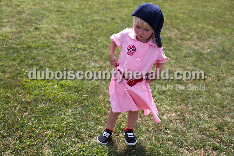 "Tegan Johnston/The Herald<br /> Amrin Vonderheide of St. Anthony, 2, pulled up the belt to her Rockford Peaches outfit while playing games during Saturday's 25th anniversary celebration of the film ""A League of Their Own"" at League Stadium in Huntingburg."
