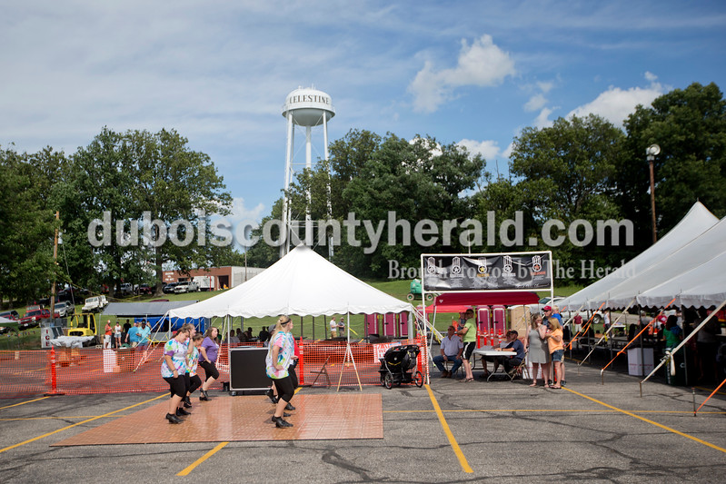 "Brittney Lohmiller/The Herald <br /> Members of the Dubois County Cloggers and Twist danced to Michael Jackson's ""Black or White"" Saturday afternoon during the 7th Celestine Streetfest."