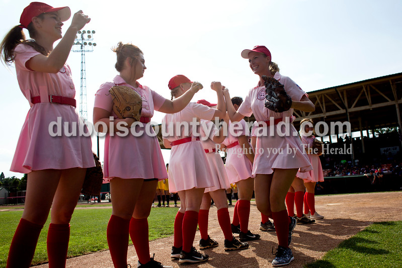 "Tegan Johnston/The Herald<br /> Rockford Peaches' Lauren Sergesketter of Holland ran past her teammates after being announced in the line-up before Saturday's game against the Belles at League Stadium in Huntingburg during the 25th anniversary celebration of ""A League of Their Own."" The Peaches and Belles tied 8-8 during the 1940s-themed rematch."