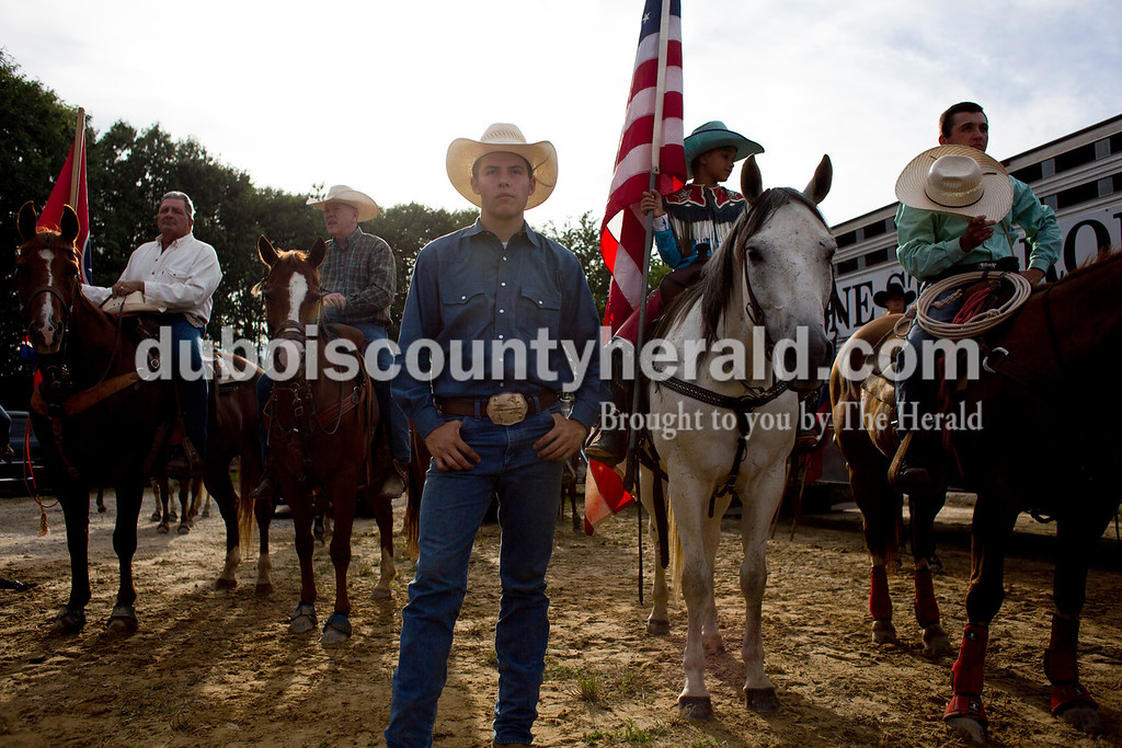 Tegan Johnston/The Herald<br /> Lane Pelham of Franklin, Tenn., 16, center, stood and waited for the start of the Lone Star Rodeo on Saturday at the Dubois County 4-H Fairgrounds in Bretzville.