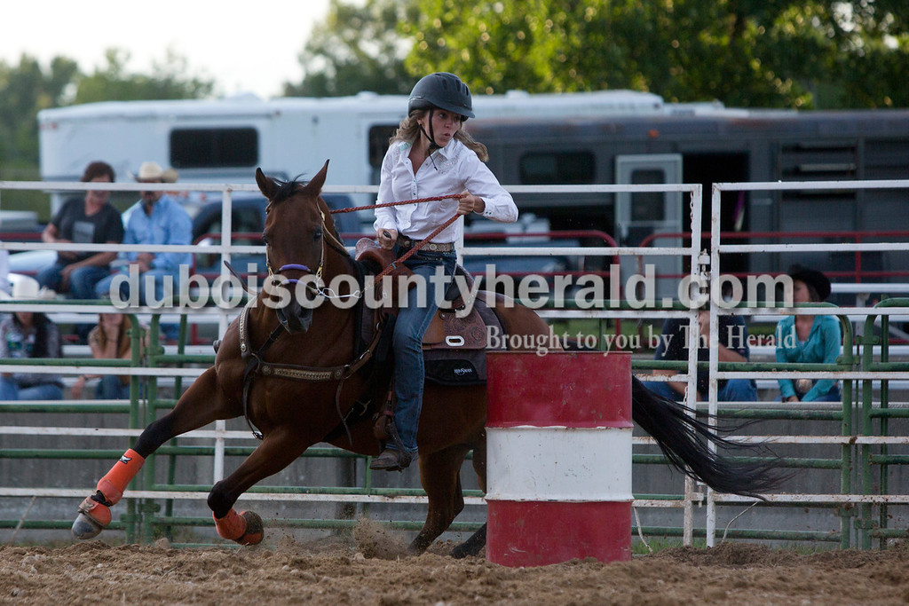 "Tegan Johnston/The Herald<br /> Kennedy Neukam of Dubois, 19, competed with her horse ""Red"" in the barrel racing during the Lone Star Rodeo on Saturday at the Dubois County 4-H Fairgrounds in Bretzville."