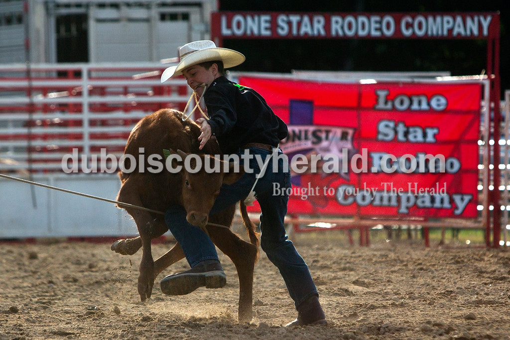 Tegan Johnston/The Herald<br /> Tanner Kane of Huntingburg, 15, tried to tie up his calf while competing in the calf roping during the Lone Star Rodeo on Saturday at the Dubois County 4-H Fairgrounds in Bretzville.