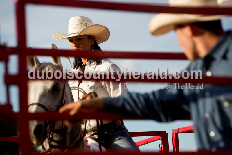 Tegan Johnston/The Herald<br /> Vanessa Madison of Crofton, Ky., positioned her horse in the corner before competing in the breakaway roping of a calf during the Lone Star Rodeo on Saturday at the Dubois County 4-H Fairgrounds in Bretzville.