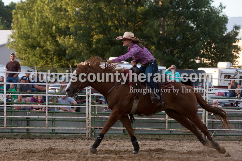 Tegan Johnston/The Herald<br /> Jessica Hoagland of Eckerty competed in the barrel racing during the Lone Star Rodeo on Saturday at the Dubois County 4-H Fairgrounds in Bretzville.