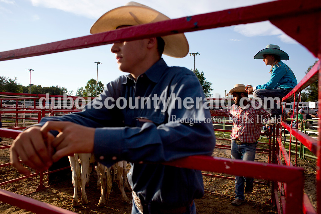 Tegan Johnston/The Herald<br /> Lane Pelham of Franklin, Tenn., 16, from left, Jamin Turner of Dixon, Tenn., and Oralee Madison of Crofton, Ky., 9, waited for the team roping to begin during the Lone Star Rodeo on Saturday at the Dubois County 4-H Fairgrounds in Bretzville.