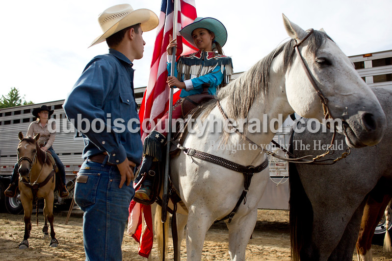 Tegan Johnston/The Herald<br /> Lane Pelham of Franklin, Tenn., 16, talked to Oralee Madison of Crofton, Ky., 9, before the start of the Lone Star Rodeo on Saturday at the Dubois County 4-H Fairgrounds in Bretzville.