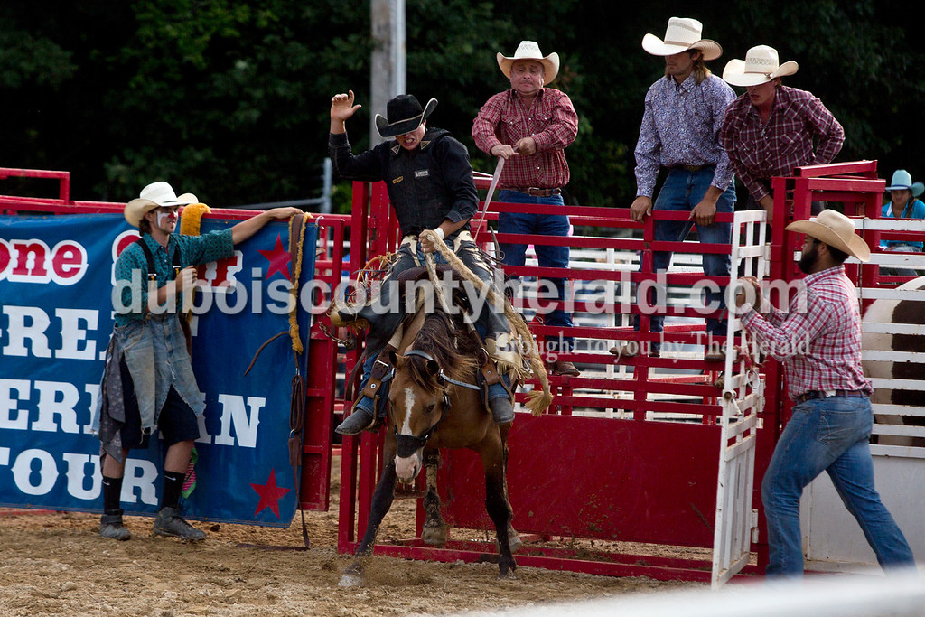 Tegan Johnston/The Herald<br /> Timothy Troyer, of Columbia, Ky., 16, competed in the saddle bronc during the Lone Star Rodeo on Saturday at the Dubois County 4-H Fairgrounds in Bretzville.