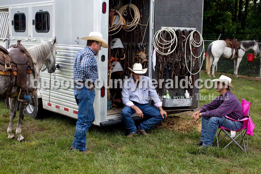 Tegan Johnston/The Herald<br /> John Daivdson of Adams, Tenn., from left, Clint Madison of Crofton, Ky., and Bradley Boyd of Princeton, Ky., talked before the Lone Star Rodeo on Saturday at the Dubois County 4-H Fairgrounds in Bretzville.