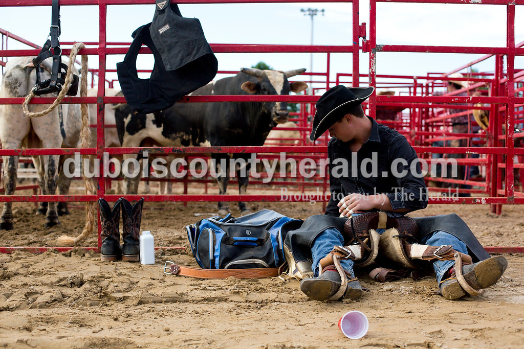 Tegan Johnston/The Herald<br /> Timothy Troyer, of Columbia, Ky., 16, tested out his stirrups before the Lone Star Rodeo on Saturday at the Dubois County 4-H Fairgrounds in Bretzville.