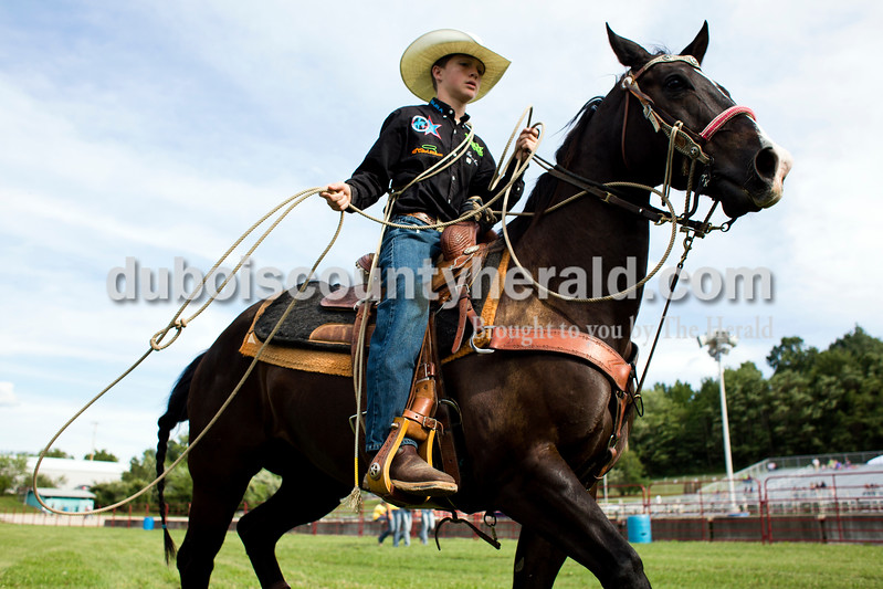 """Tegan Johnston/The Herald<br /> Tanner Kane of Huntingburg, 15, warmed-up with his horse """"Blackjack"""" before the Lone Star Rodeo on Saturday at the Dubois County 4-H Fairgrounds in Bretzville."""