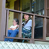 Mom and son, southern porch sitters.  Mark with his banjo