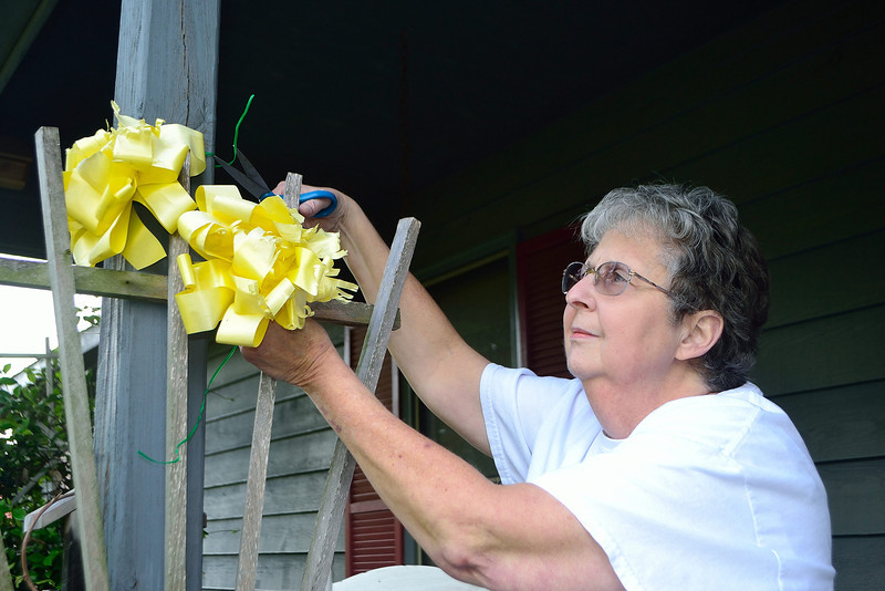 Grandma un-decorating our house.  One yellow ribbon for Mark Robert in Afghanistan and one ribbon for Roger Park while in Kuwait.  We were so glad and thankful to see this era come to a happy end.