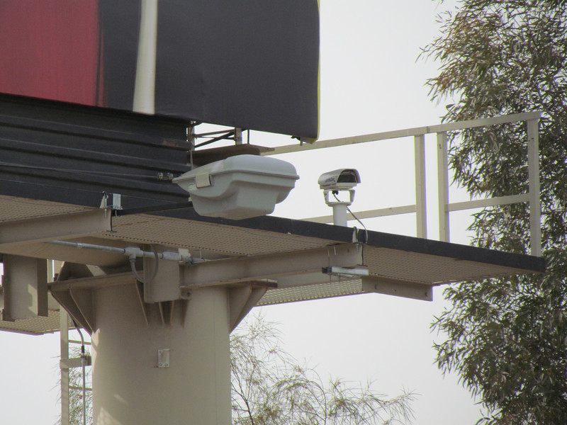 The webcam is on the lower right corner of an advertising sign.  Here it is using telephoto.