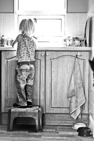 Child Washing Dishes