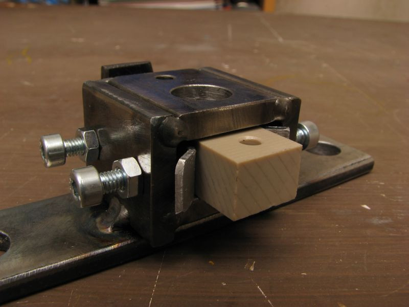 Dril Jig for manufacturing an insulator block.  Made to be adaptable to different size blocks.