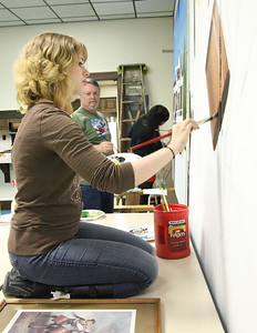 "03Mar2013__ Raven Richardson, in the foreground, works on her painting which will show Archibold Willard painting ""The Spirit of 76"", while Fred Farschman and Krista Berry paint the American House. photo by Ray Riedel"