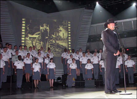 """The West Point Glee Club backs up Trace Adkins during a rehearsal on Friday for the 44th Annual Academy of Country Music Awards show in Las Vegas.  Adkins, backed up by the Glee Club, will debut his new song, """"Til the Last Shot's Fired"""", during the awards program on Sunday night.  The show can be seen on CBS beginning at 8 p.m. (Photo by Cadet Timothy Keilty)"""