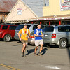 A runner and his pacer running through downtown Foresthill in the Western States 100 race.