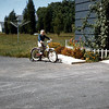 Riding my new bike as my grandfather looks on, 1955 or 56.  My family owned that house from 1954 to 2011.