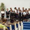 Vanessa (far left), singing in school choir.