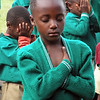 Praying children from Mbingo Baptist Primary School, Cameroon.<br /> <br /> The children at Mbingo Baptist School pray every morning before class. They were like<br /> children anywhere -- squirming, squealing, peaking -- and praying, too.